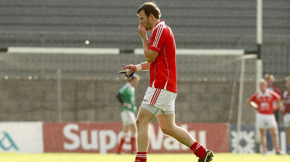 Louth's Mark Brennan walks off the field after seeing red