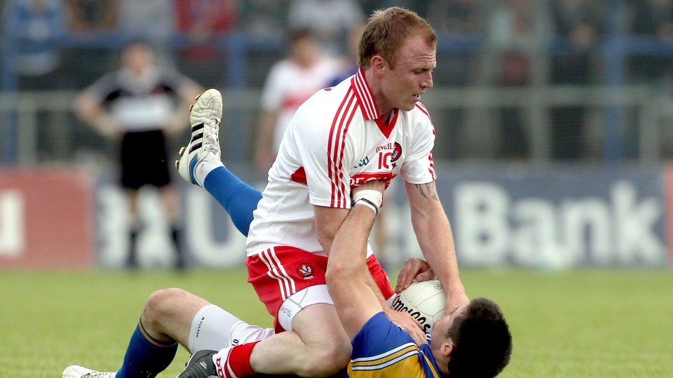 Martin Donaghy of Derry pins Longford's Shane Mulligan to the ground