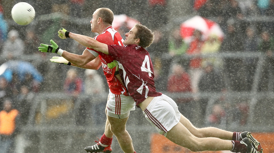 Louth's Darren Clarke is challenged by Kevin Maguire of Westmeath