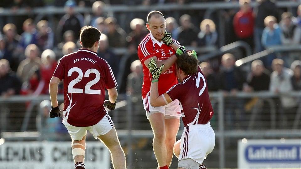 Clarke drags an injured Doran Harte of Westmeath