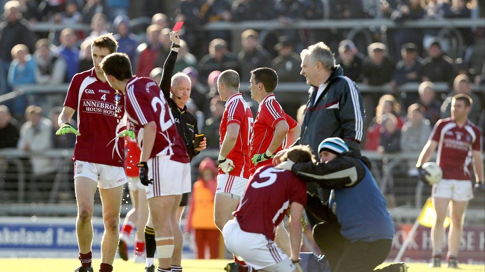 Referee Derek Fahy dismisses Darren Clarke of Louth