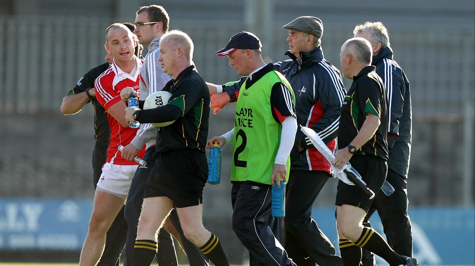 Clarke tries to speak with referee Derek Fahy after his dismissal