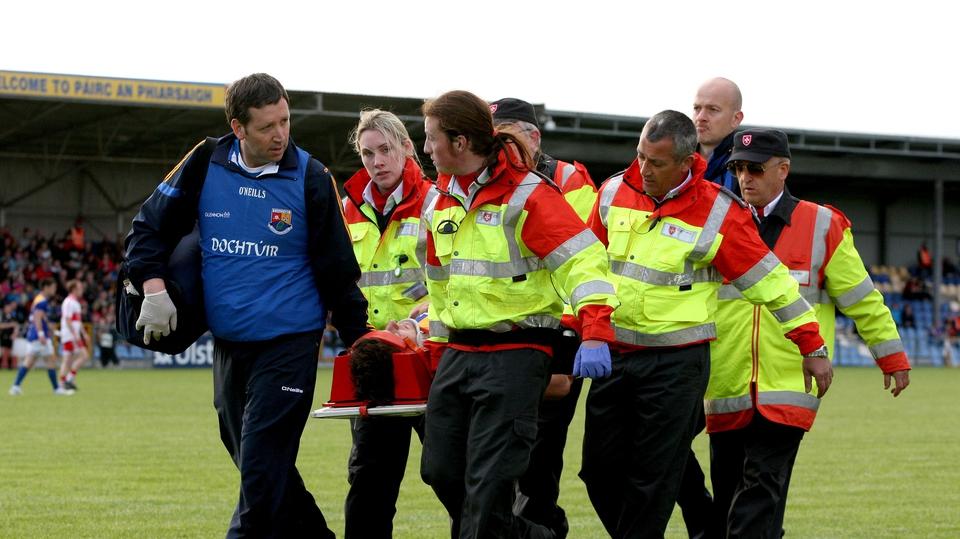Longford's John Keegan is taken off with a neck injury