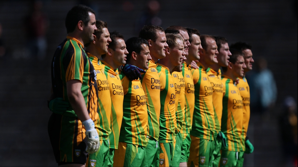 The Donegal players stand for the national anthem in Clones
