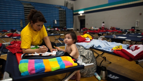 A mother and son rest in a Red Cross shelter after power was knocked out to thousands of homes in Maryland