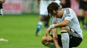 Mesut Oezil reacts to Germany's exit after their 2-1 loss to Italy