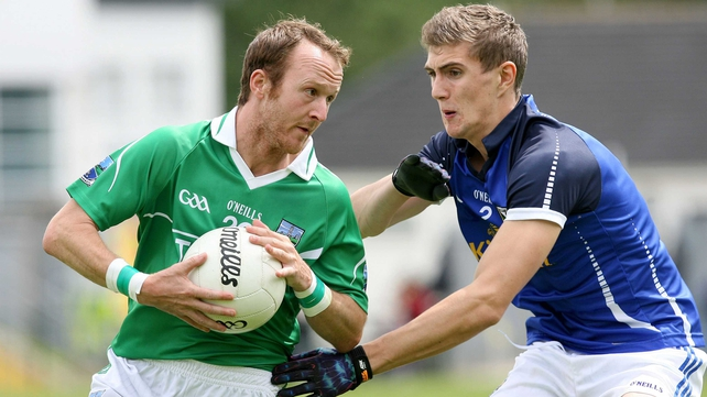 Paul Ward of Fermanagh holds off Cavan's Killian Clarke