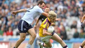 Wexford's Ben Brosnan slips past Dublin captain Bryan Cullen