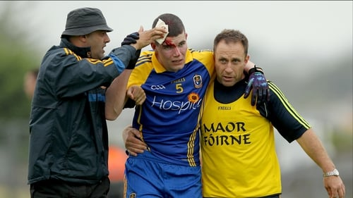 Roscommon's Cathal Dineen leaves the field with a blood injury