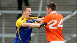Roscommon's Seanie McDermott and Gavin McParland of Armagh test the quality of each other's jerseys