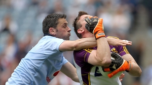 Dublin's Alan Brogan comes in high on Wexford goalkeeper Anthony Masterson