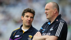 Wexford manager Jason Ryan (l) shares a word with his Dublin counterpart Pat Gilroy