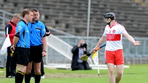 Derry's Alan Grant protests his innocence to the match officials at Casement Park