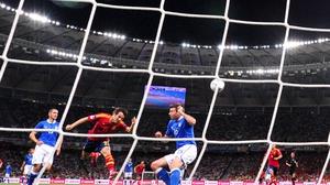 David Silva heads the Spanish in front