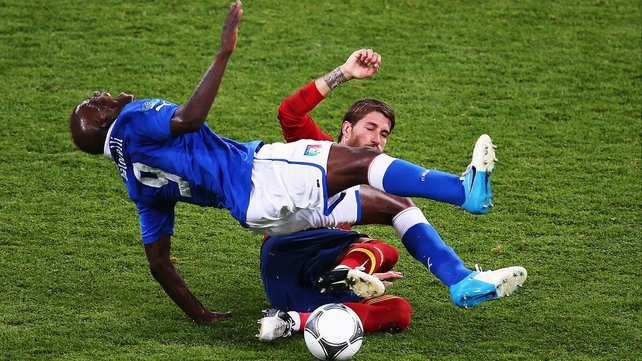 Mario Balotelli feels the effects of Sergio Ramos' tackle