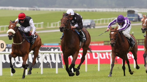 Sapphire (red cap) in action at the Curragh last season