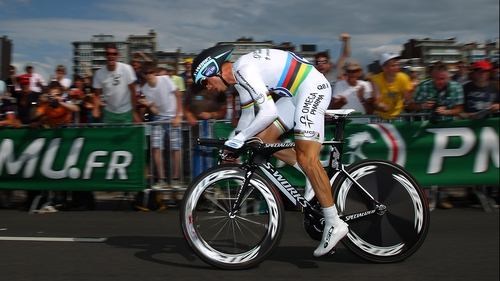 World time-trial champion Tony Martin is determined to continue despite the injury he picked up on Sunday