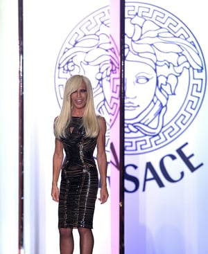 Donatella Versace, creative director of her brother's brand, poses at the finale of her show last night