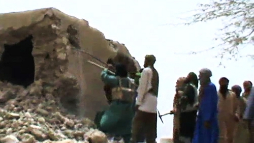 A still from a video showing the destruction of an ancient shrine in Timbuktu
