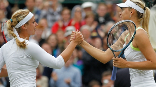Maria Sharapova (r) congratulates Sabine Lisicki of Germany after the match
