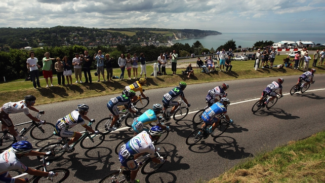 The peleton take the coast road earlier today