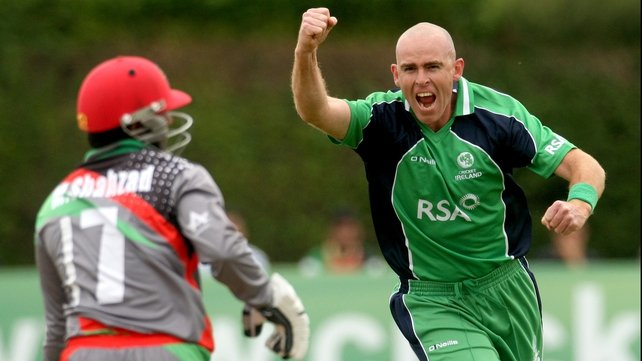 Ireland's Trent Johnston celebrates the wicket of Mohammad Shahzad of Afghanistan caught by William Porterfield