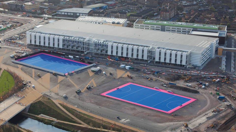 The hockey pitches are located beside the International Broadcast Centre (seen here while under construction)