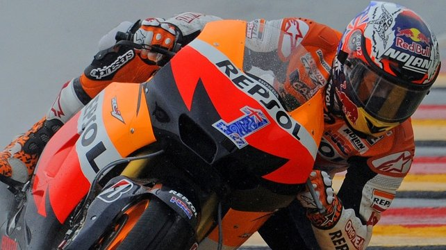 Casey Stoner took top spot with a best time of one minute 31.796 seconds late in the session