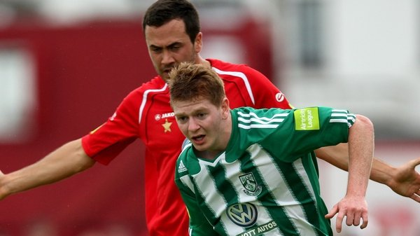 Sligo Rovers' Ross Gaynor stays close to Adam Hanlon of Bray