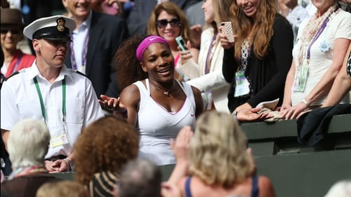 Serena Williams makes her way to the players' box