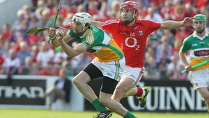 Cork's Paudie O'Sullivan attempts to hook David Kenny of Offaly