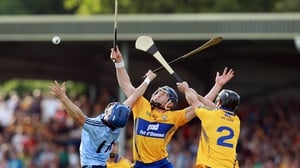 David Treacy competes for a high ball with Domhnall O'Donovan and Conor Cooney of Clare