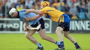 Dublin forward Liam Rushe attempts to escape the clutches of Cian Dillon