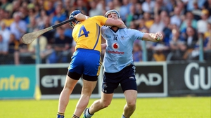 Clare's Conor Cooney comes in high on David Treacy of Dublin