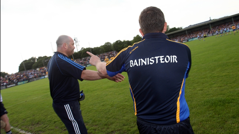Former Clare team-mates become adversaries as Dublin boss Anthony Daly and Fitzgerald shake hands before the match in Ennis
