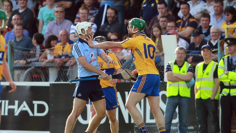 Michael Carton of Dublin and Fergal Lynch of Clare clash off the ball