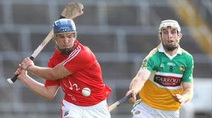 Horgan gets the sliotar away despite the efforts of Kevin Brady