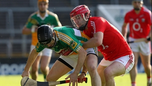Cork's Paudie O'Sullivan challenges David Franks of Offaly