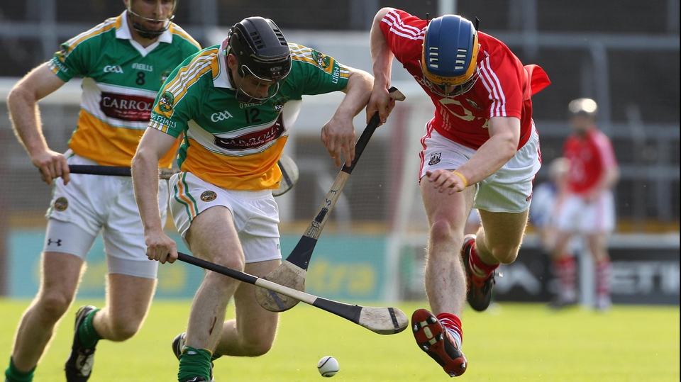 Cork's Darren Sweetnam and Brendan Murphy of Offaly tussle for possession