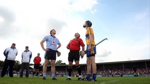 Captains Johnny McCaffrey and Patrick Donnellan and referee Diarmud Kirwan watch for the result of the pre-match coin toss