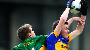 Tipperary's Colman Kennedy wins an aerial dual against Shane O'Connor of Kerry