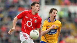 Cork's Donncha O'Connor is pursued by Kevin Harnett