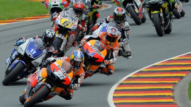Spain's Dani Pedrosa of Repsol Honda Team (front) leads the pack