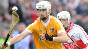 Antrim's Aaron Graffin attempts to lose Derry's Paddy Henry