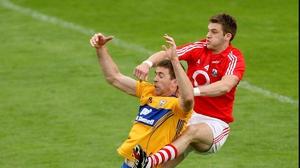 Cork defender Eoin Cadogan rises above Gary Brennan