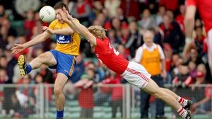 Cork's Denis O'Brien executes a brilliant block to deny Gary Brennan