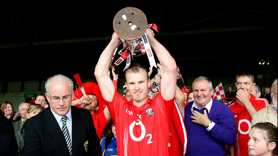 Cork captain Michael Shields holds the Munster trophy aloft