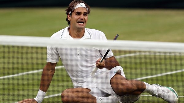 Roger Federer is overcome with emotion after claiming his first major since 2010