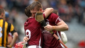 Andy Smith (l) embraces Joe Canning after the historic win