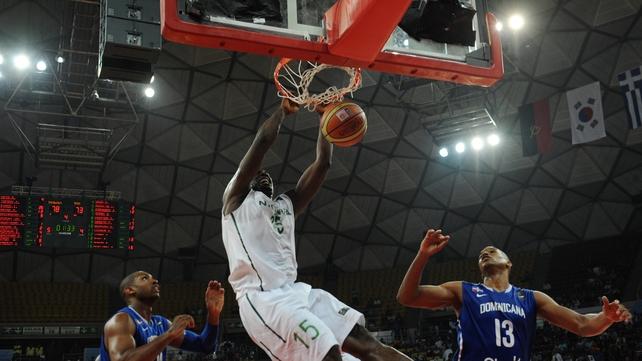 Olumide Oyedeji (centre) of Nigeria scores against Dominican Republic